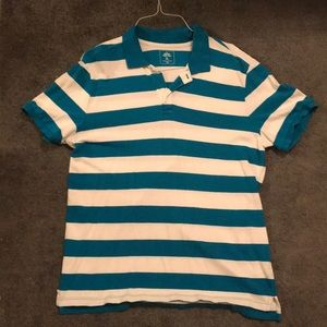Men's blue and white striped polo